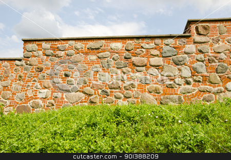 Restored ancient wall made of red brick and stones. stock photo, Restored ancient wall made of red brick and stones. by sauletas