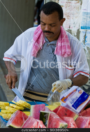Colombian fruit seller stock photo, CARTAGENA DE INDIAS , COLOMBIA - DEC 16:Unidentified colombian man sell fruits in the street in Cartagena de Indias on December 16 2010 by Kobby Dagan