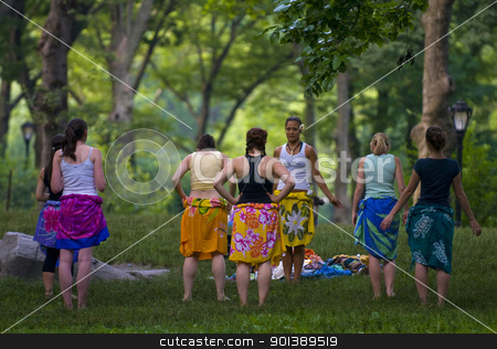 Central park belly dance stock photo, NEW YORK - JUNE 28 2011 : A group of women rehearse belly dancing in Cental park , Manhattan  by Kobby Dagan
