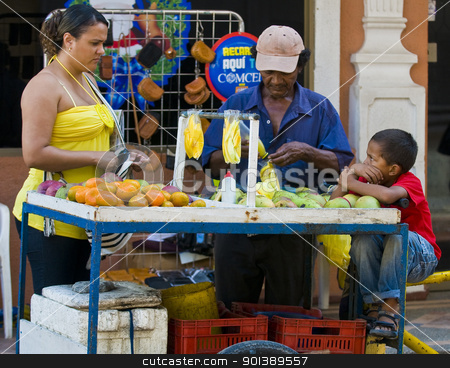Colombian fruit seller stock photo, CARTAGENA DE INDIAS , COLOMBIA - DEC 21:Unidentified colombian man sell fruits in the street in Cartagena de Indias on December 21 2010 by Kobby Dagan