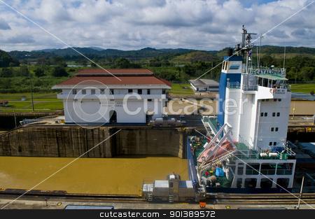 Panama canal stock photo, PANAMA CANAL , PANAMA - DEC 25 2010 : Huge ship crossing the Panama canal by Kobby Dagan