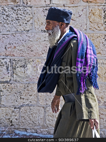 Ethiopian priest stock photo, Ethiopian priest walking near the Westren wall in Jerusalem by Kobby Dagan