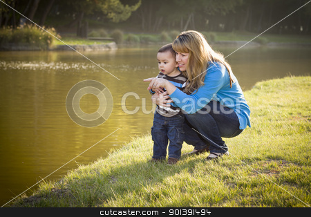 Happy Mother and Baby Son Looking Out At Lake stock photo, Happy Mother and Baby Son Looking Out At The Pretty Lake. by Andy Dean