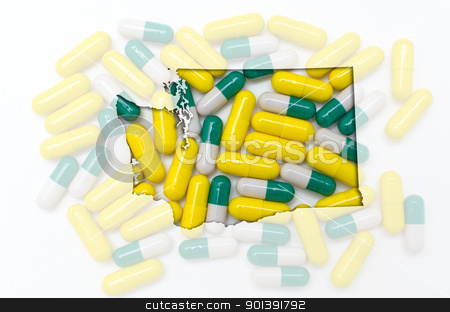 Outline map of washington with transparent pills in the backgrou stock photo, Outlined washington with transparent background of capsules by Vedran Vukoja