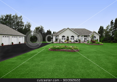 A very neat and tidy home in suburbs stock photo, a newly constructed, modern rural home with big yard  by Melissa King