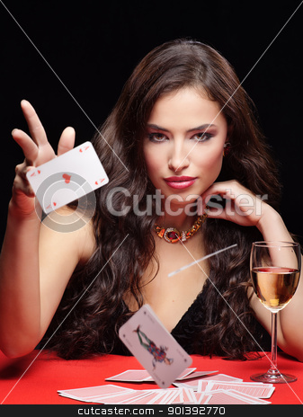 young woman gambling on red table stock photo, pretty young woman gambling on red table by iMarin