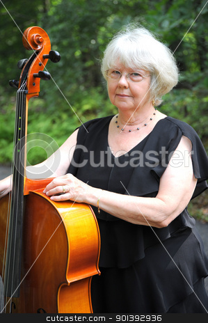 Female cellist. stock photo, Female cellist standing with her cello outside. by OSCAR Williams