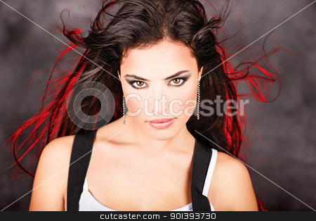 Pretty woman with red light behind her long hair stock photo, Pretty woman with red light behind her long hair by iMarin