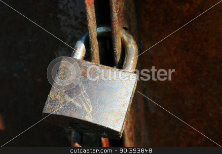 Old lock stock photo, Closeup view of an old lock on an iron door by John Young