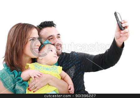 Closeup of happy family smiling over white background taking sel stock photo, Closeup of happy family smiling over white background taking self portrait   by dacasdo