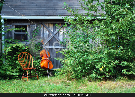Cello outside. stock photo, Cello standing against a wall outside. by OSCAR Williams