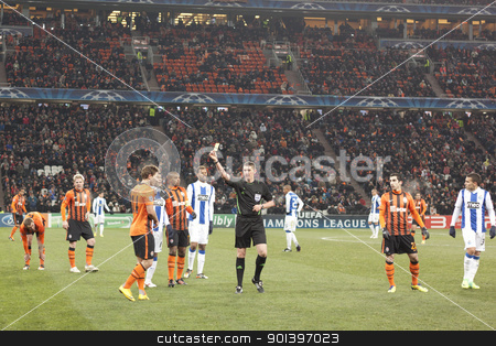 Referee Craig Thomson (SCO) shows a yellow card stock photo, DONETSK, UKRAINE - NOVEMBER 23, 2011: Referee	Craig Thomson (SCO) shows a yellow card Vasyl Kobin (No. 14, Shakhtar) in the match of the Champions League FC Shakhtar Donetsk vs. FC Porto in Donetsk Donbass Arena on November 23, 2011. by virin
