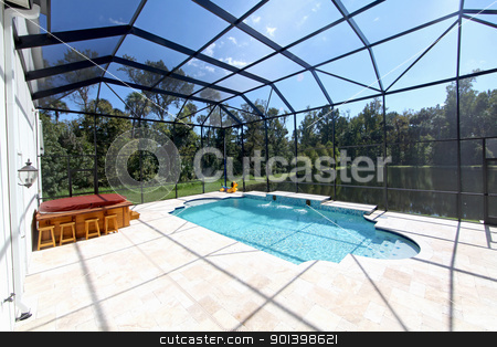 Swimming Pool with Lake View stock photo, A Swimming Pool and Hot Tub with Lake View. by Lucy Clark