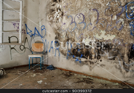 chair in decayed room stock photo, Chair in decayed room interior. Peeling moldy wall and smudged paint. by sirylok