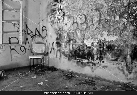 chair in decayed room stock photo, Chair in the corner of a decayed room with peeling moldy wall. Black and white. by sirylok