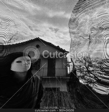 masked figure behind threaded window stock photo, Masked figure behind threaded window. Black and white. by sirylok