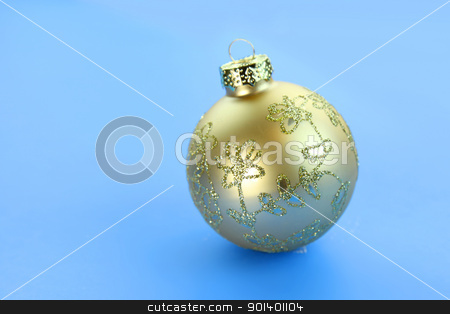 Christmas ornament stock photo, Single golden Christmas ornament on the blue background  by Sreedhar Yedlapati