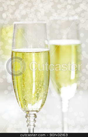Champagne and Snow stock photo, Close up photograph of a champagne glass on a blurry background by mpessaris