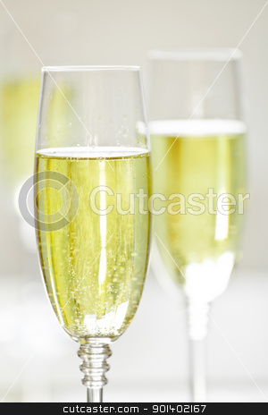 Champagne stock photo, Close up photograph of a champagne glass on a blurry background by mpessaris