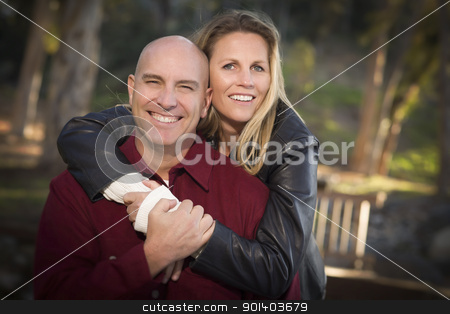 Attractive Couple Portrait in the Park stock photo, Attractive Hugging Young Couple Portrait in the Park. by Andy Dean