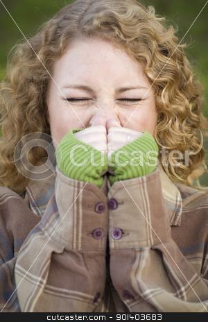 Pretty Young Woman Sneezing stock photo, Pretty Young Woman Sneezing Outdoors. by Andy Dean