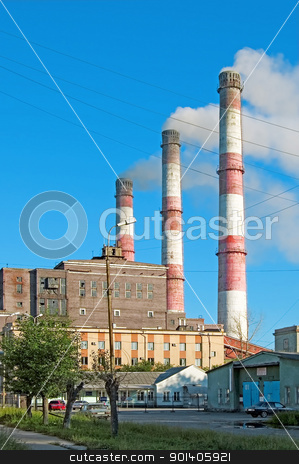 hydro power plant stock photo, Pipes and building hydropower plants on the background of blue sky in the town of Serov by rezkrr