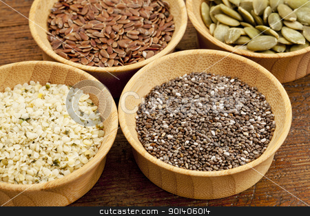 chia and other healthy seeds stock photo, chia, hemp, flax and pumpkin - healthy seeds in small wooden bowls by Marek Uliasz