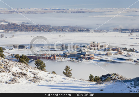 foothills of Fort Collins, Colorado stock photo, foothills of Fort Collins, Colorado with university building and solar farm, a winter scenery with snow and fields of fog by Marek Uliasz