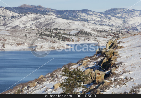 mountain lake in winter scenery stock photo, Horsetooth REservoir in Fort Collins, Colorado with a view of Lory State Park and Greyrock - winter scenery with fresh snow by Marek Uliasz