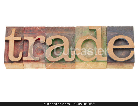 trade world in letterpress type stock photo, trade - isolated world in vintage wood letterpress printing blocks by Marek Uliasz