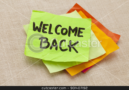 welcome back stock photo, welcome back - handwriting on a green sticky note against canvas board by Marek Uliasz