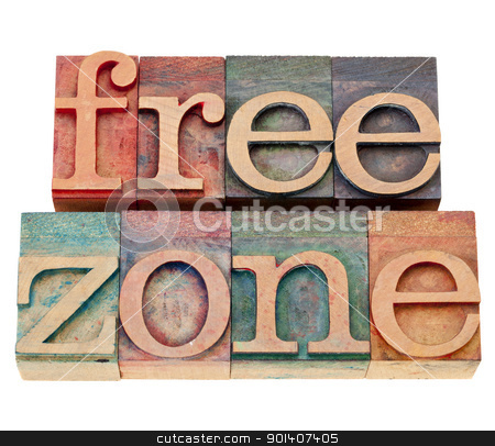 free zone in letterpress type stock photo, free zone  - isolated text  in vintage wood letterpress type by Marek Uliasz