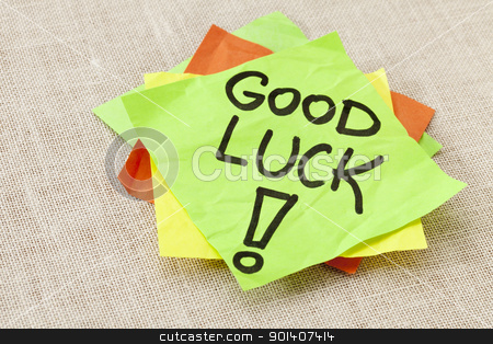 Good luck on sticky note stock photo, Good luck - black handwriting on green sticky note against canvas by Marek Uliasz