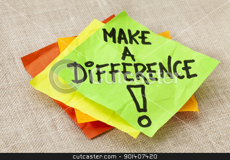 Make a difference reminder stock photo, Make a difference -motivational reminder on green sticky note against canvas board by Marek Uliasz
