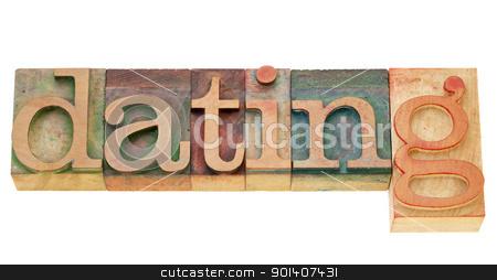 dating word in letterpress type stock photo, dating - isolated word in vintage wood letterpress type by Marek Uliasz