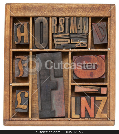 antique letterpress type in wooden box stock photo, a variety of vintage letterpress printing blocks with big letter F in a small wooden typesetter box with dividers, isolated on white by Marek Uliasz