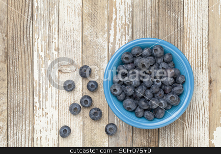 bowl of blueberries stock photo, blueberries in a blue ceramic bowl on a grunge white painted wood surface by Marek Uliasz