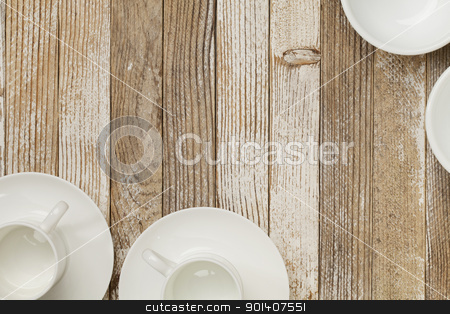 coffee cups on grunge wood stock photo, white china espresso coffee cups and other dishware on grunge white painted wood table by Marek Uliasz