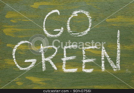 go green sign stock photo, go green sign - white chalk handwriting on plywood board painted green by Marek Uliasz