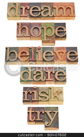 motivational words in letterpress type stock photo, dream, hope, believe, dare, risk, try - a set of motivational and spiritual isolated words in vintage wood letterpress printing blocks by Marek Uliasz
