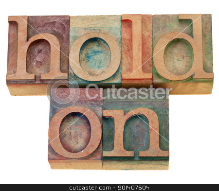 motivational concept - hold on stock photo, motivational concept - hold on - isolated phrase in vintage wood letterpress type by Marek Uliasz
