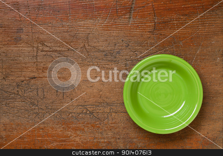 green bowl on grunge wood stock photo, green ceramic bowl on grunge scratched wood surface by Marek Uliasz