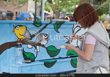 Painting mural on the piano stock photo, FORT COLLINS, COLORADO, USA - JUNE 18, 2011: Artist Ren Burke is painting a mural on the piano in Fort Collins Old Town Square as part of Pianos About Town public art program. June 18, 2011. by Marek Uliasz