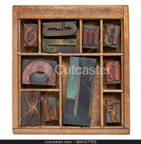 vintage letterpress printing blocks stock photo, a variety of vintage letterpress printing blocks with big letter L in a small wooden typesetter box with dividers, isolated on white by Marek Uliasz