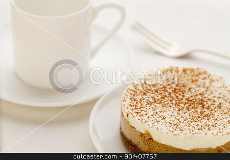 mocha cheesecake stock photo, a round mocha cheesecake  on platte with a cup espresso coffee by Marek Uliasz