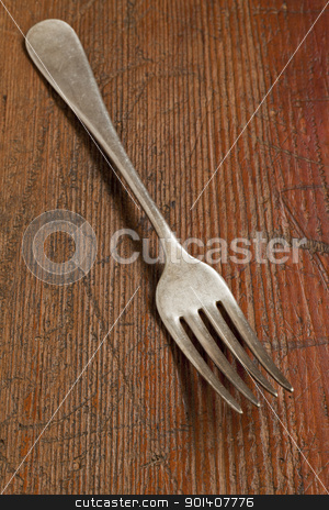 vintage fork stock photo, vintage fork on scratched grunge wood surface by Marek Uliasz