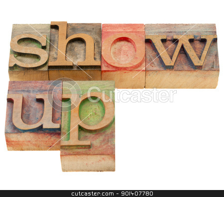 show up in letterpress type stock photo, show up - motivation concept - isolated text in vintage wood letterpress printing blocks by Marek Uliasz