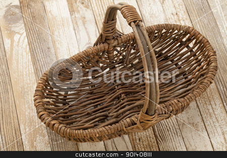 empty wicker basket stock photo, empty wicker basket on grunge white painted wood background by Marek Uliasz