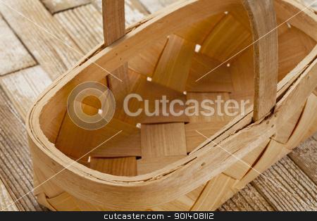 rustic wicker basket stock photo, empty wicker basket on grunge white painted wood background by Marek Uliasz