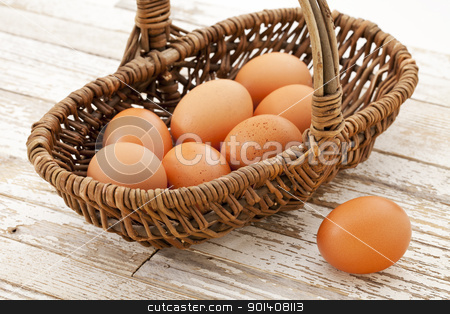 basket of brown eggs stock photo, basket of brown chicken eggs against grunge wooden table with white peeling off paint by Marek Uliasz